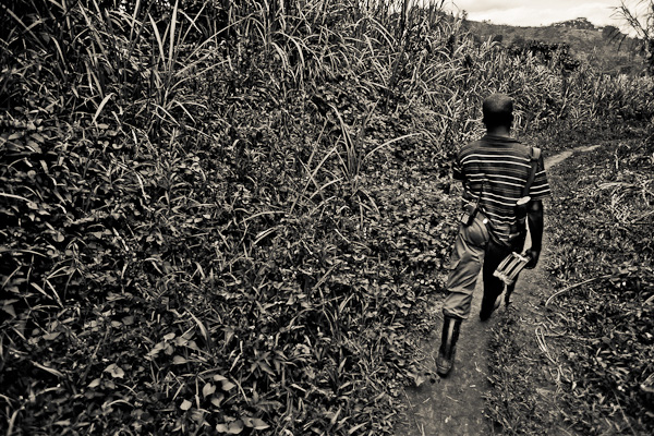 An FDLR rebel escorts the photographer through the jungle.