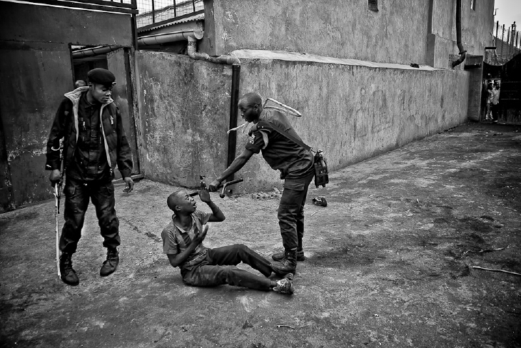 Street boy is beaten by police in Goma.