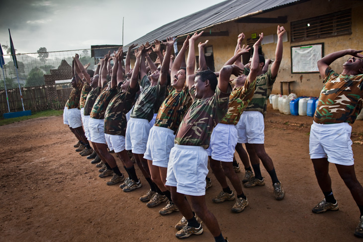 Indian Army peacekeepers in Kibua laugh as part of a yoga exercise.