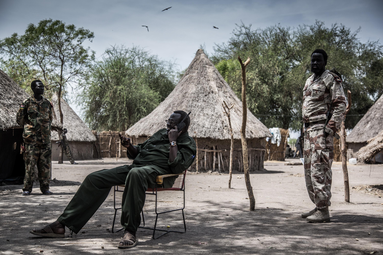 Dr. Riek Machar speaks on a satellite phone near Akobo, South Sudan