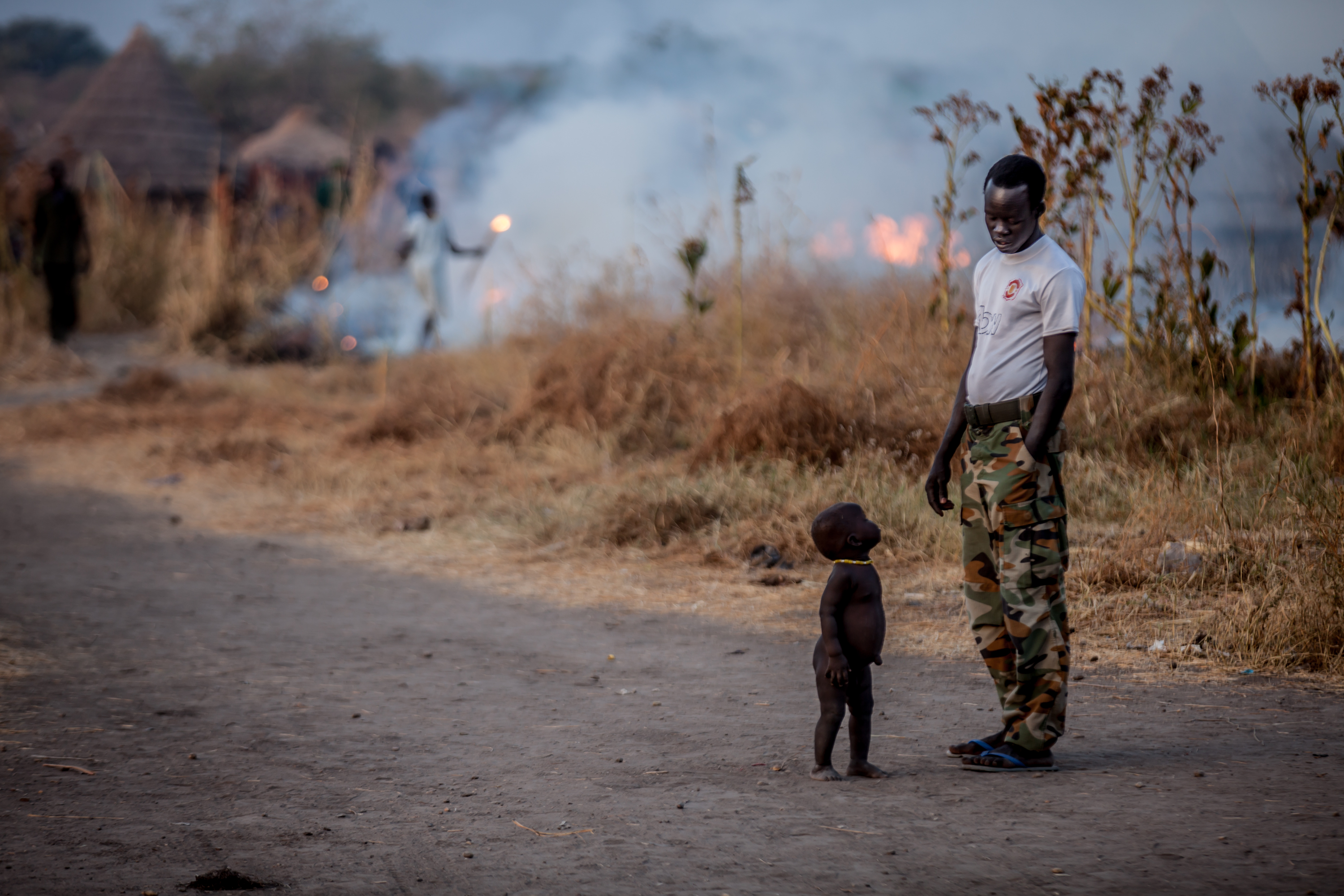 A soldier and baby at Dr. Riek Machar\'s secret base near Akobo, South Sudan.