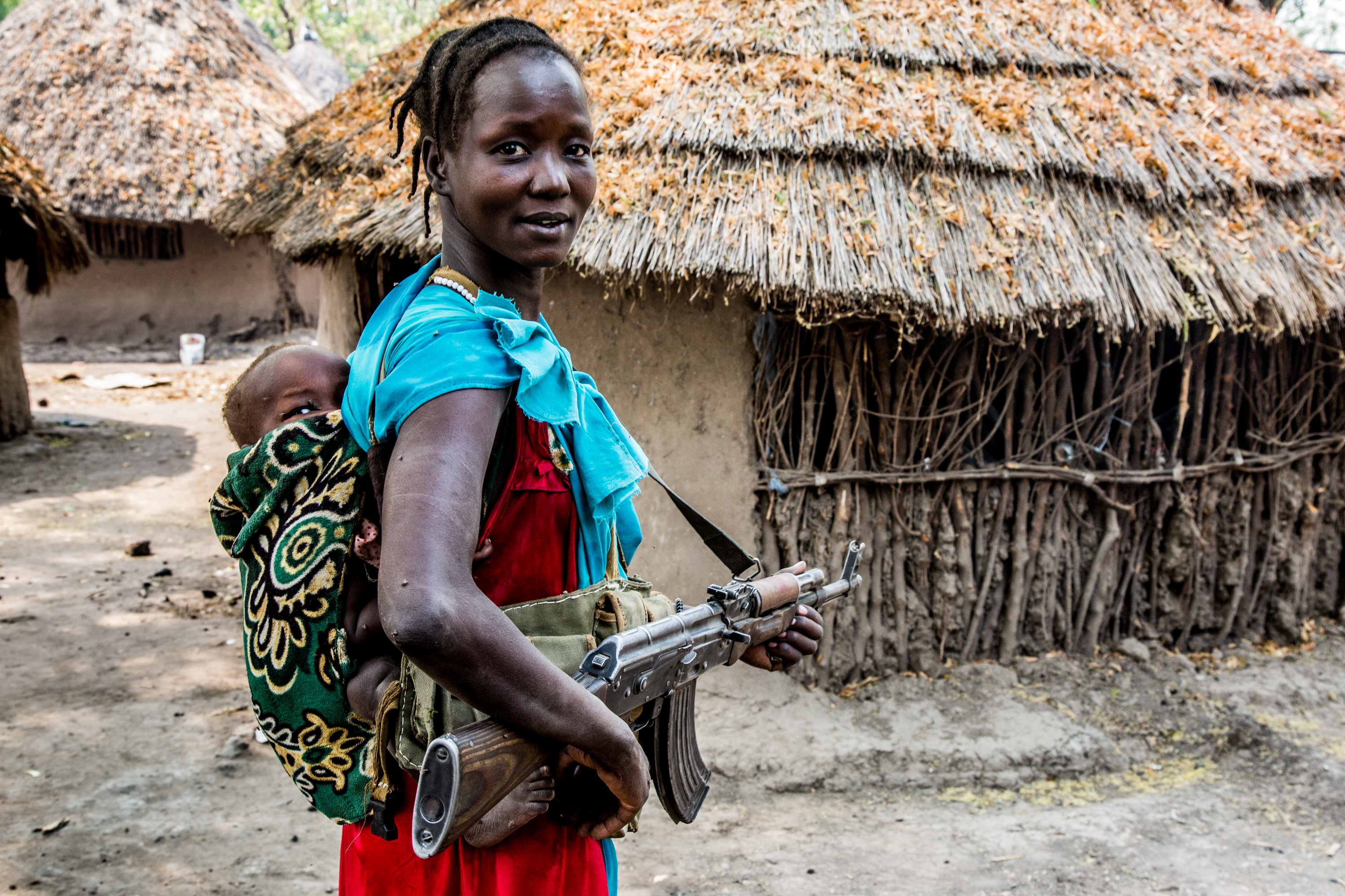 A woman poses with her weapon at a rebel camp in Akobo, S Sudan