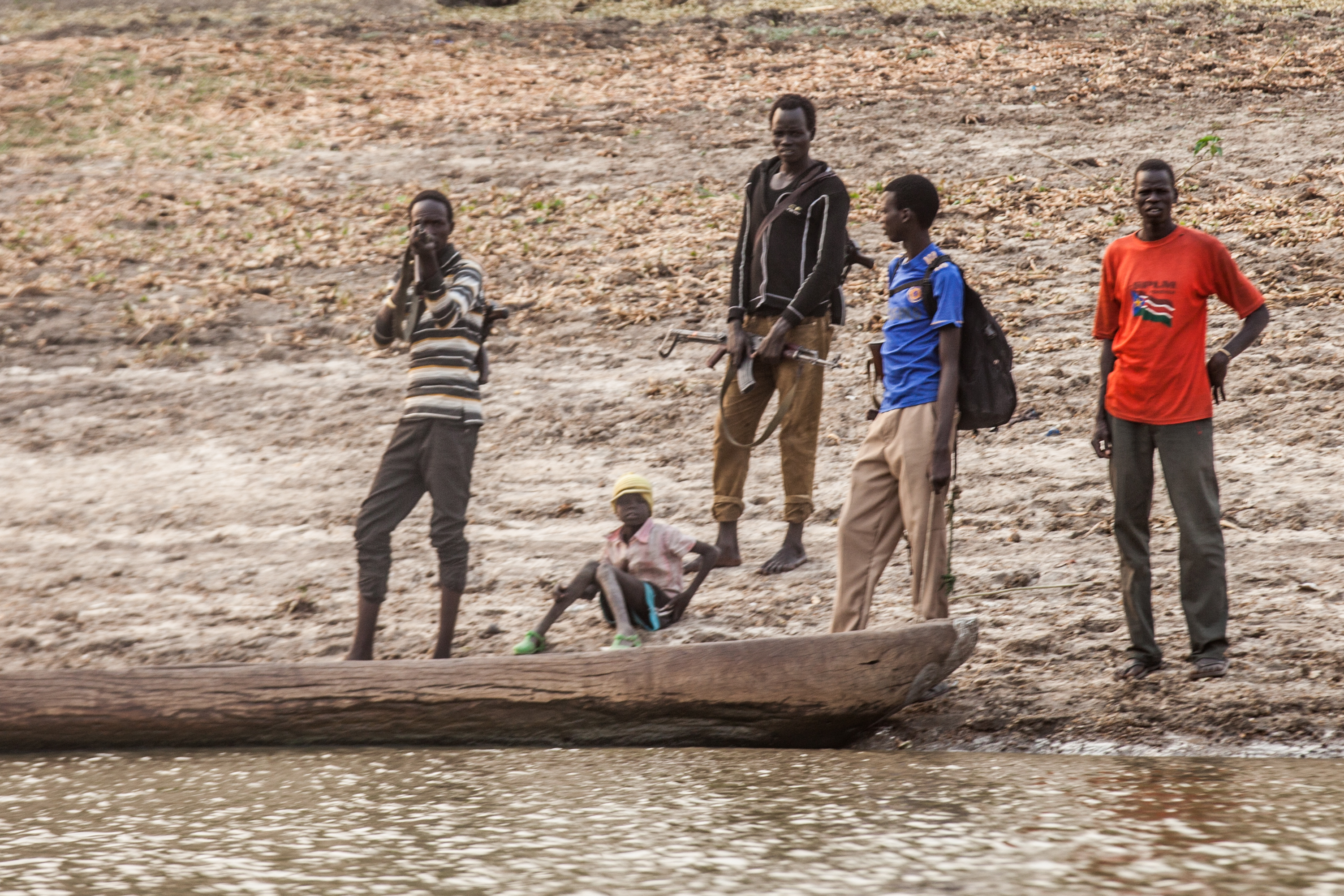 A man points his rifle at the photographer between Akobo and Nasir, S Sudan