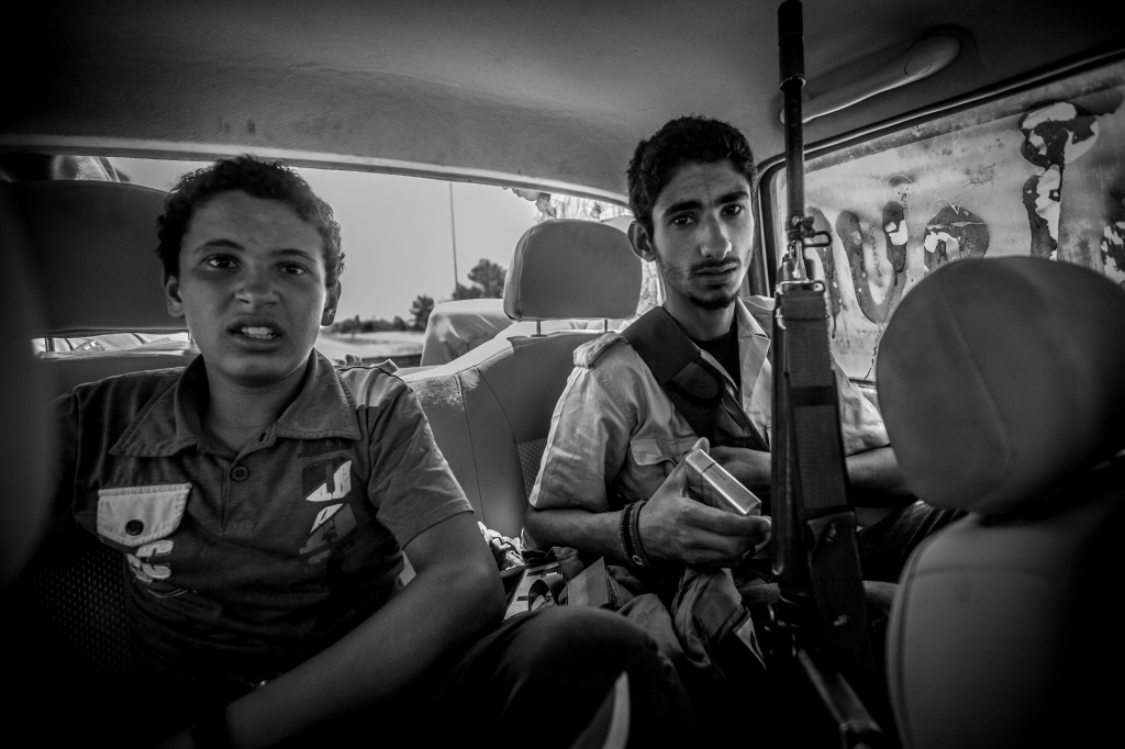"Boys head to the Misrata front to fight in the Libyan civil war. 1/100 signed 13""x19"" 310 gram Hahnemuhle Matte Fine Art Paper."