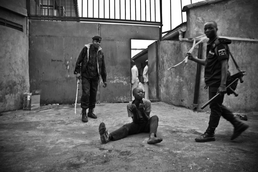 Police, Goma DRC. 1/100 signed 13