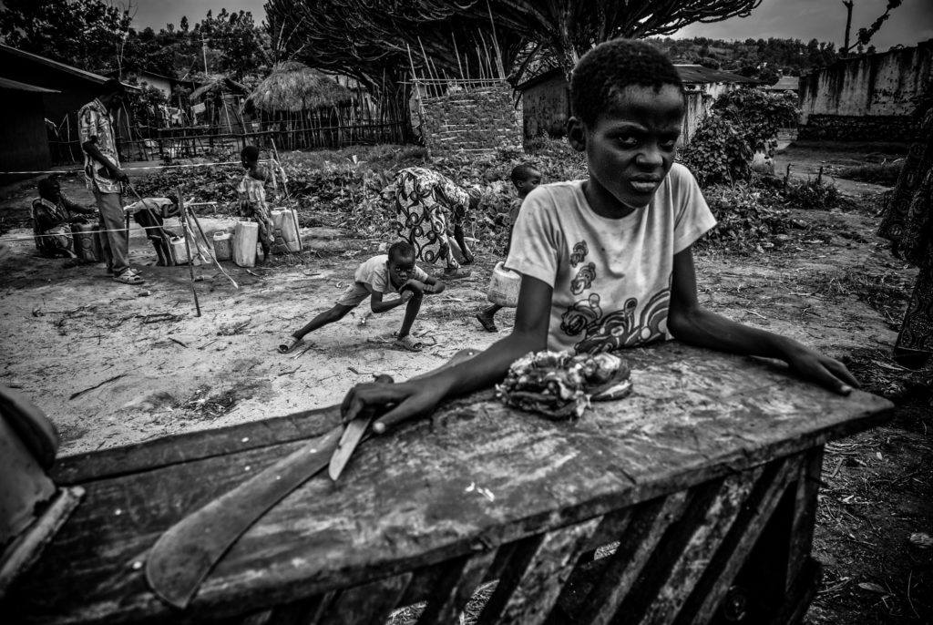 Butcher boy in Eastern Congo. 1/100 signed 13