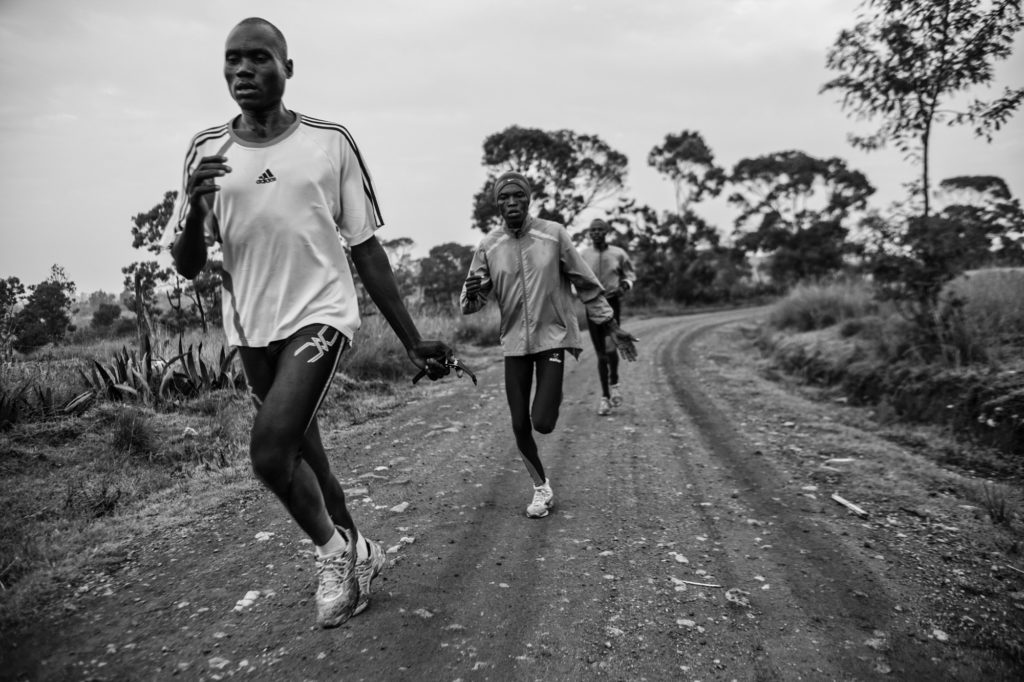 Marathon runners train at high altitude near Iten, Kenya. Children play in Eastern Congo. 1/100 signed 13